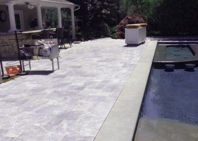 Silver Travertine Tiles from Silvas Turkey with Harkaway Bluestone pool coping