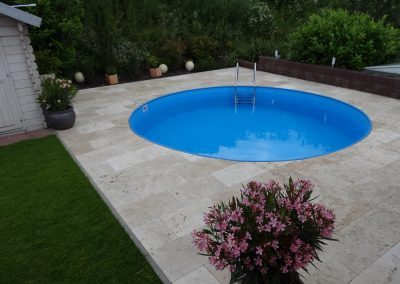 Travertine Tiles from Turkey around a swimming pool