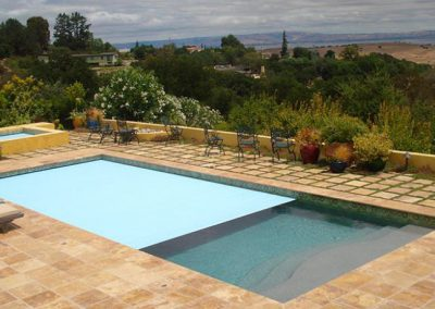 Noce travertine tiles and pool coping